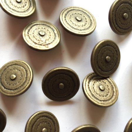 Bronze colour metal button