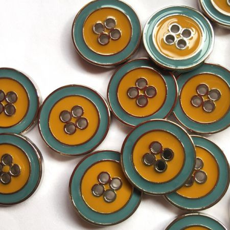 Silver rim metal button with green, blue & mustard yellow enamel