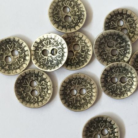 Zinc like metal button with embossed design