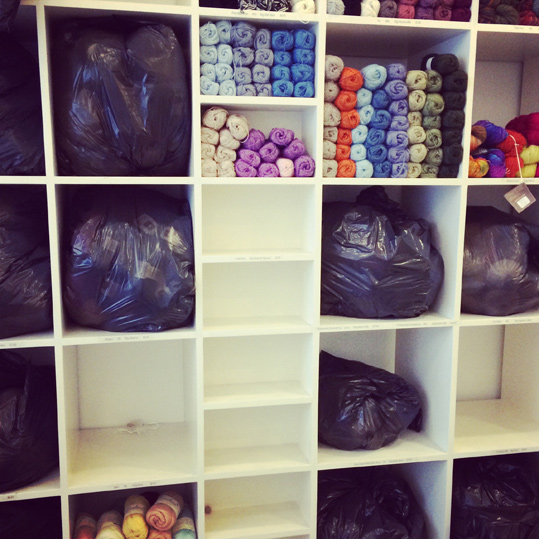 Closing the shop for a few days, packing away the yarns to protect them from dust and odours.