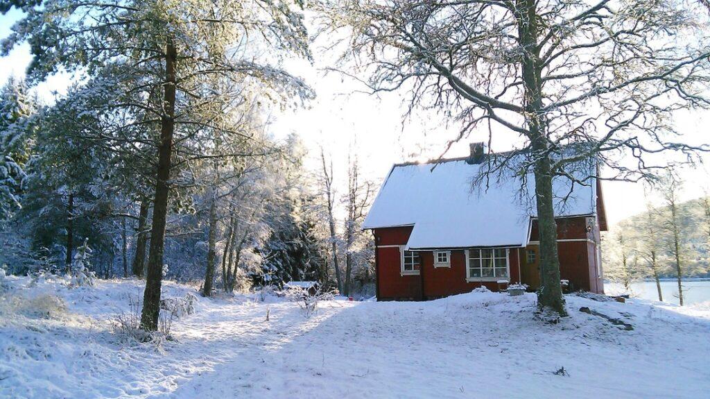 The farmhouse in the winter snow.