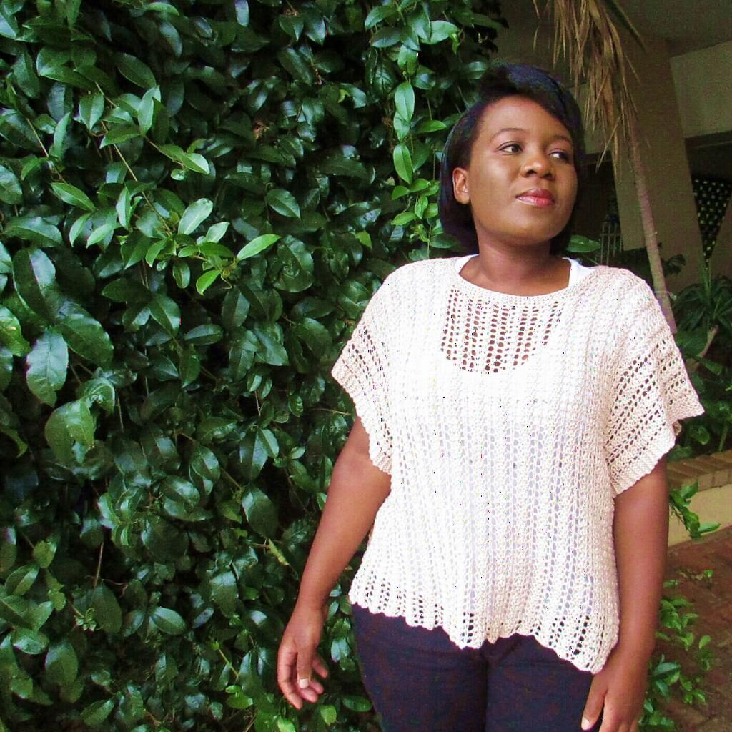 35e6288dd83 ... by Noma Ndlovu is a gorgeous open lace work poncho. This would make a  great light and airy layer over a t-shirt. Knit on larger needles in a  simple two ...