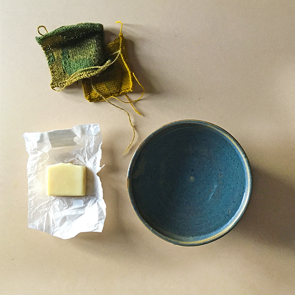 Hey Mama Wolf Wool Soap and clean, bowl filled with lukewarm water